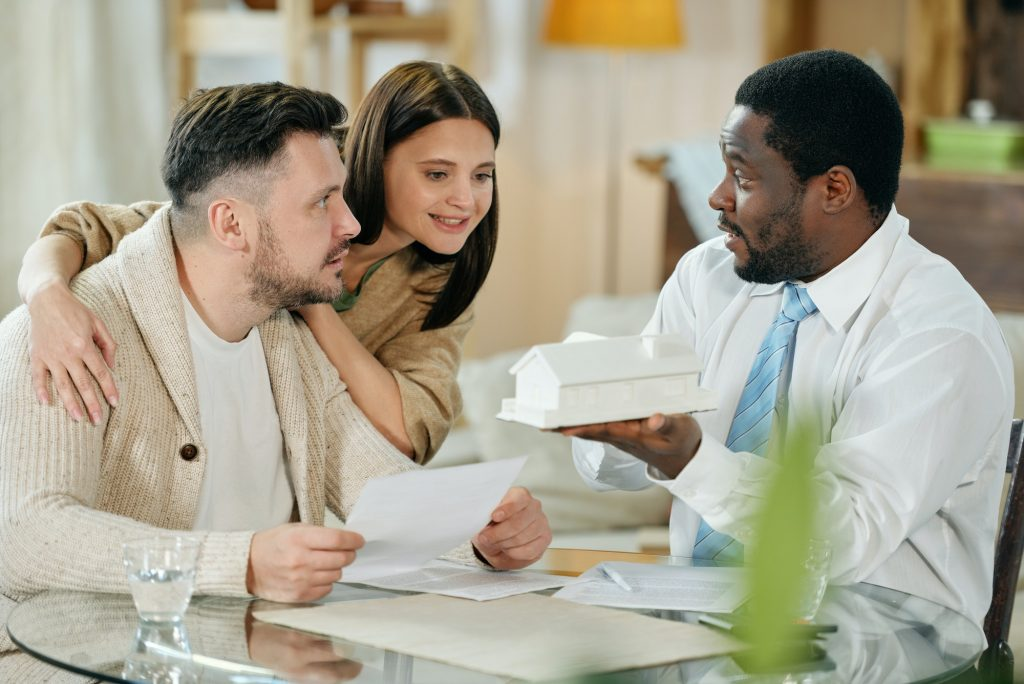Young couple with mortgage consultant