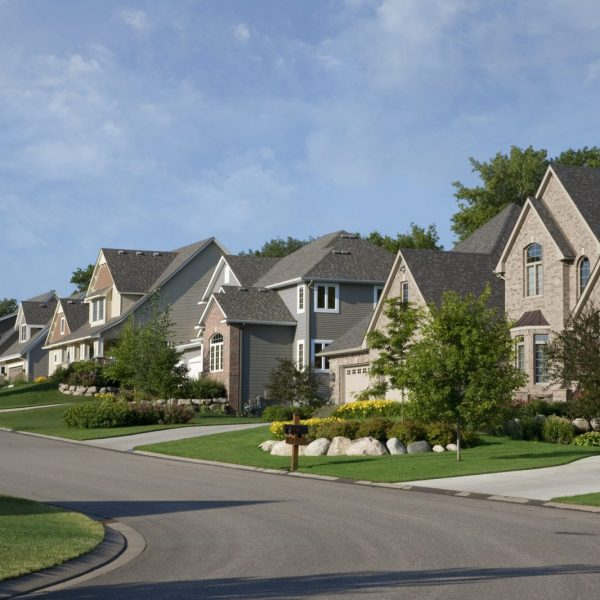 Street and houses of upscale neighborhood on a summer morning